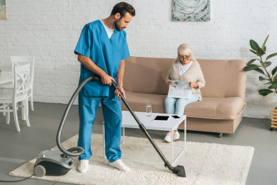 male caregiver cleaning