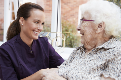 female caregiver and senior woman looking at each other