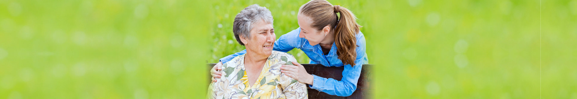 senior woman and female caregiver looking at each other